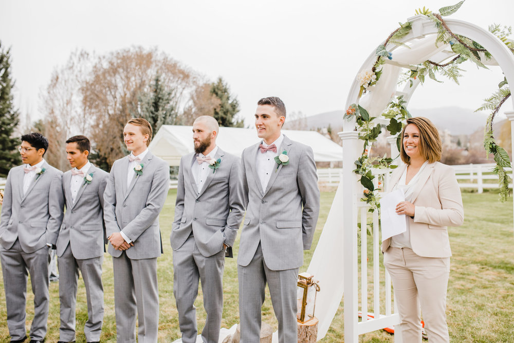 best wedding photographer in logan utah wedding arch outdoor wedding reception gray suits