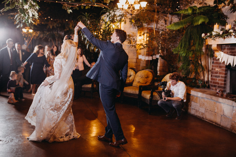 professional wedding photographer in cache valley utah first dance wedding reception romantic holding hands twirling photo