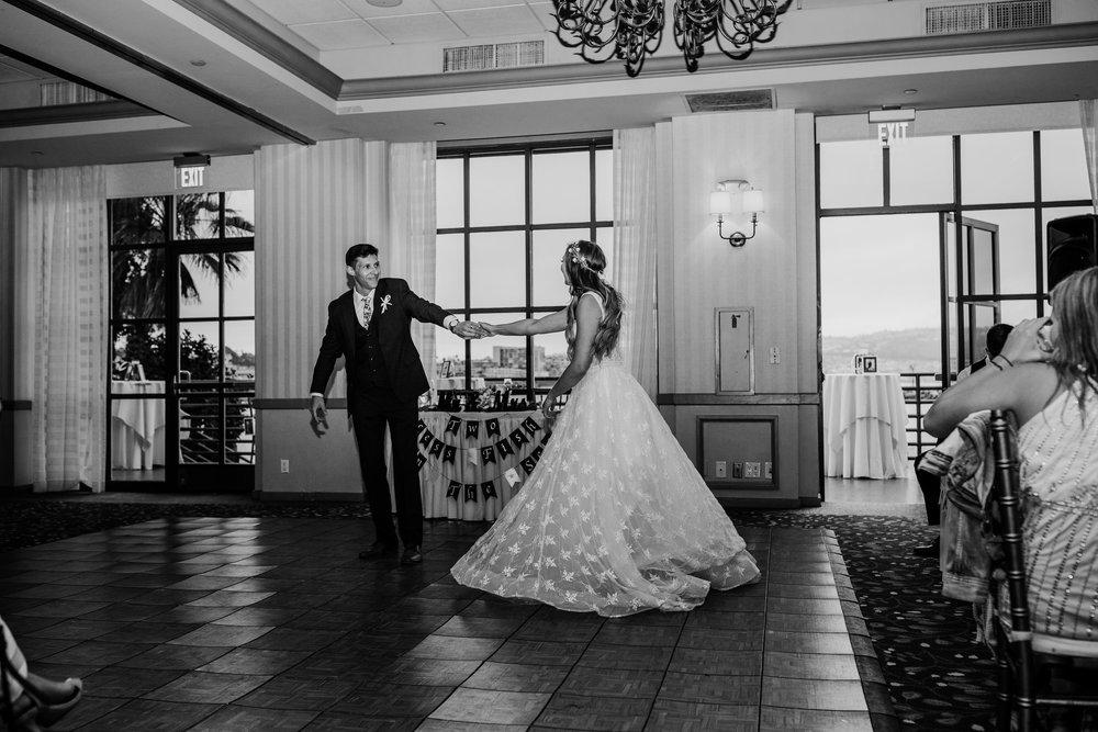 Best wedding photographer i brigham city utah first dance holding hands wedding reception