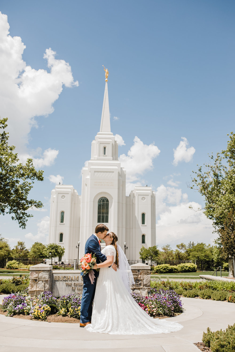 Professional Wedding Photographer in Brigham City Utah LDS Temple Wedding modest wedding dress kissing summer wedding