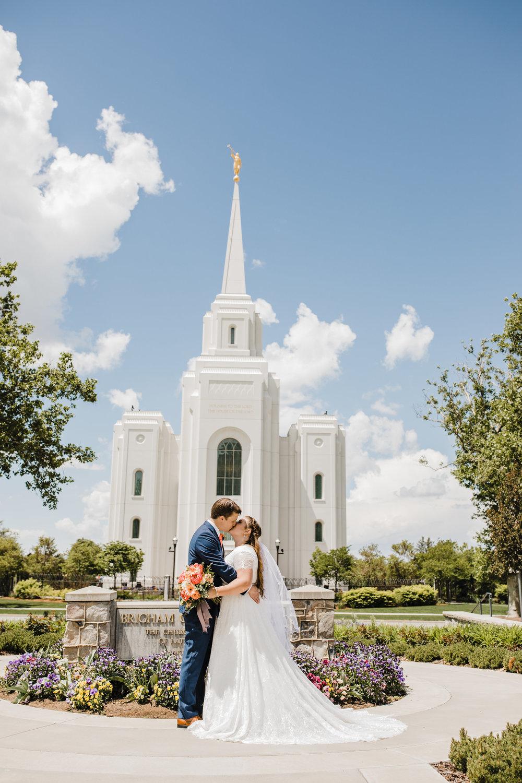 Professional Wedding Photographer in Brigham City Utah LDS Temple Wedding modest wedding dress kissing summer wedding