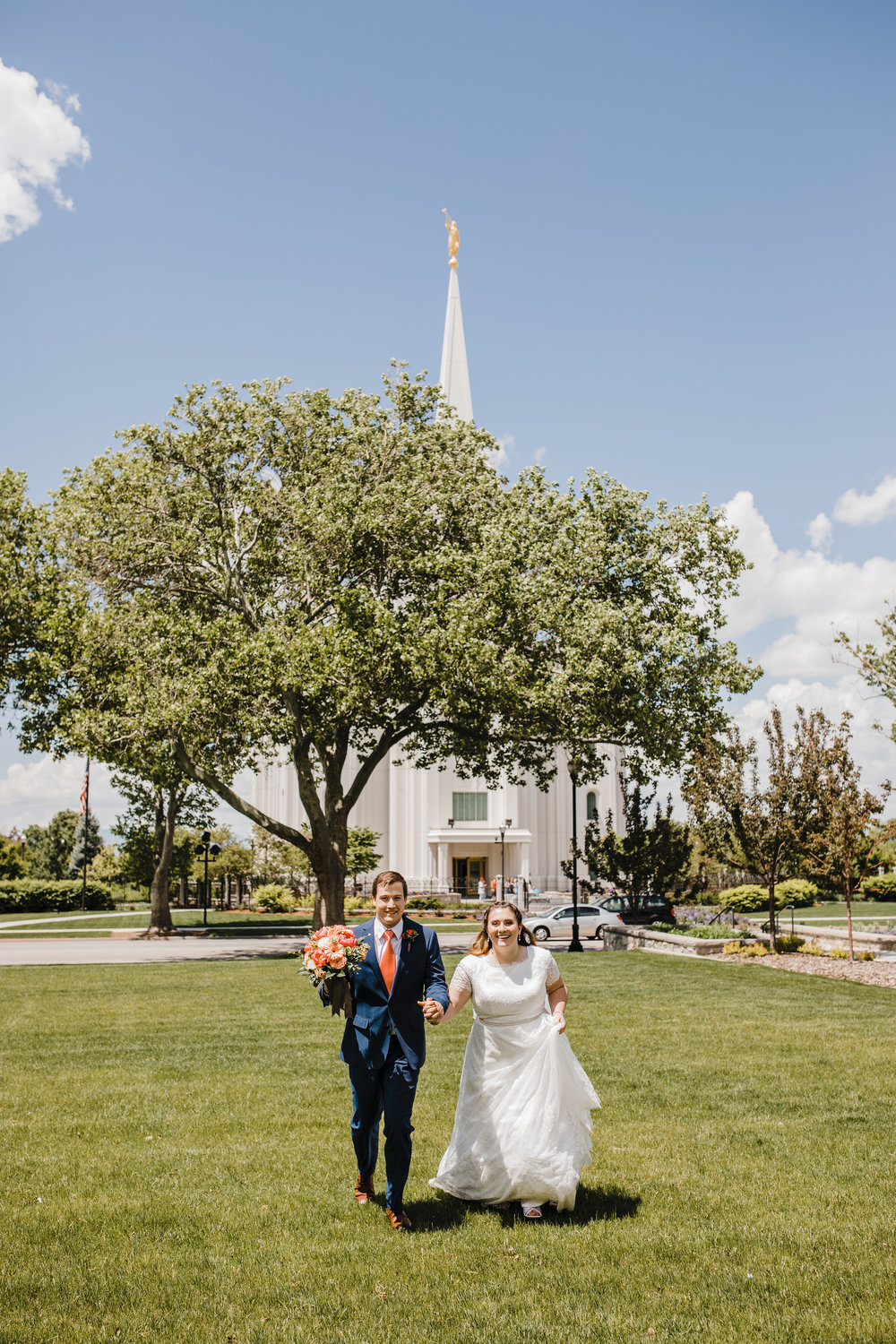 Professional Wedding Photographer in Brigham City Utah Couple pictures holding hands running LDS temple wedding