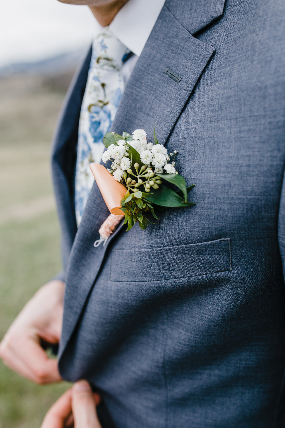 professional wedding photographer in cache valley utah groom boutineer wedding tie suit