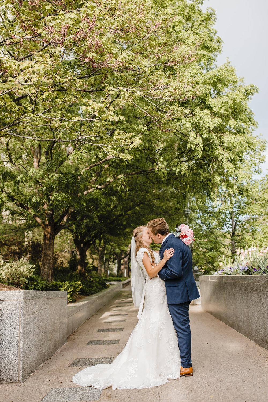 Temple Wedding Aurora Colorado Professional Wedding Photographer Kissing Temple Grounds LDS Modest Wedding Dress Wedding Bouquet