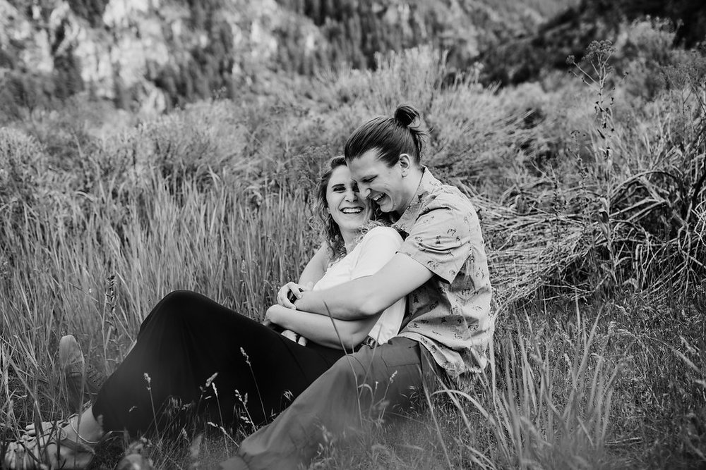 black and white engagement photography couple laughing professional wedding photographer calli richards northern utah