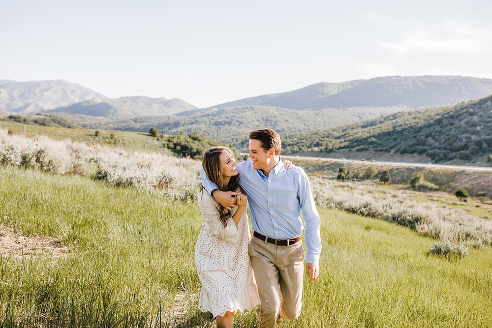 cache valley sardine canyon engagement photography couple walking and laughing