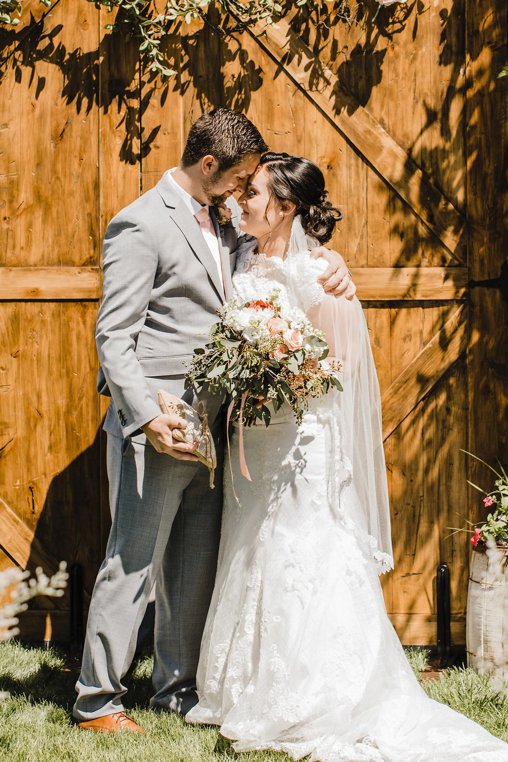 bride and groom after wedding ceremony happy couple central utah wedding photography barn wood