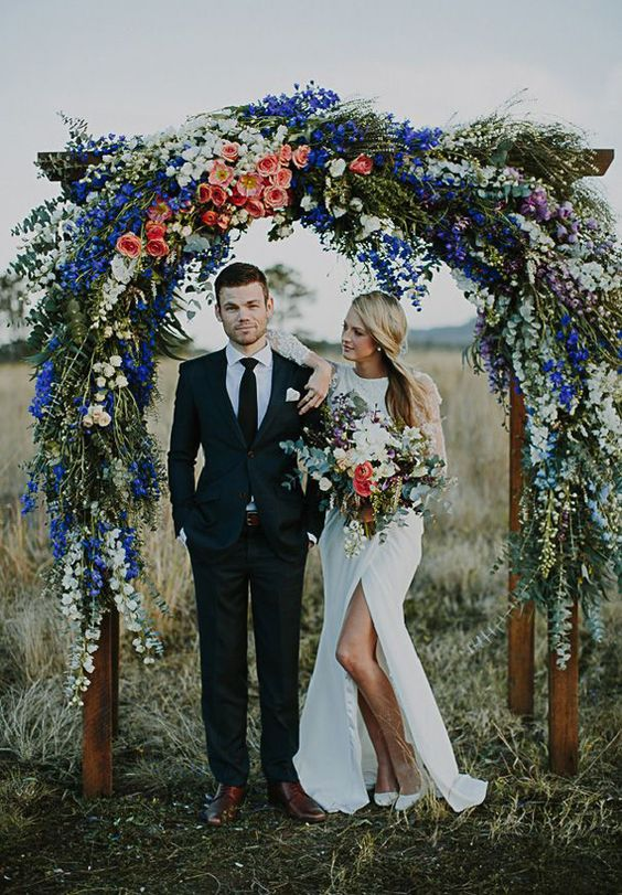 bohemian wedding arch for your outdoor wedding summer wedding blue flowers draping flowers