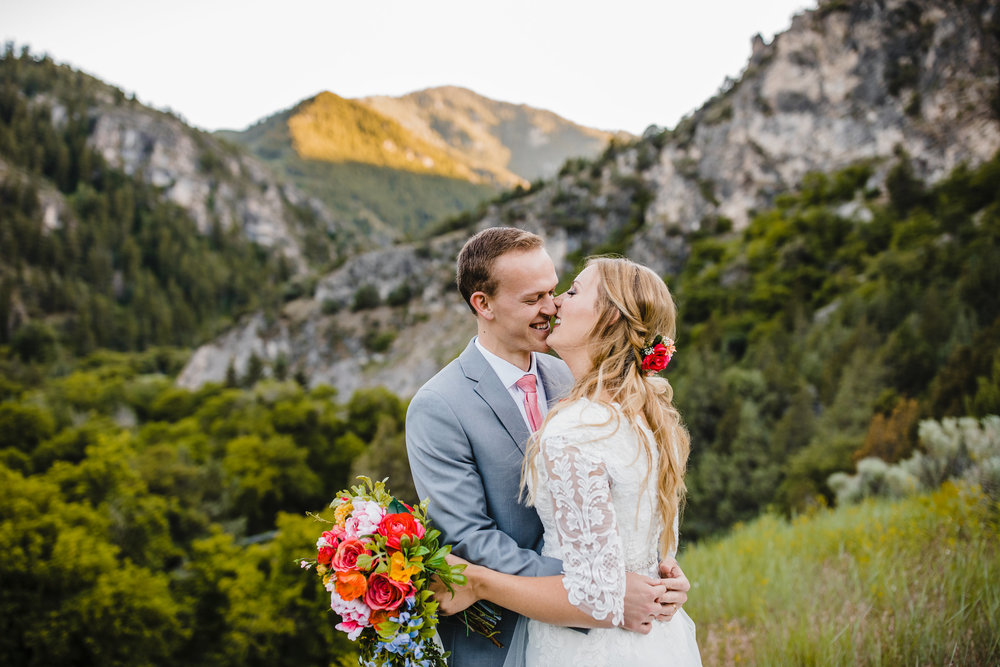 Best professional wedding photographer in utah valley laughing bride and groom mountain wedding