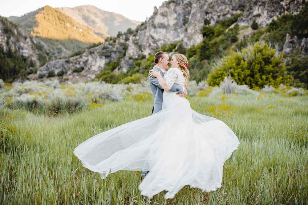 best professional wedding photographer in logan utah spinning movement bride and groom