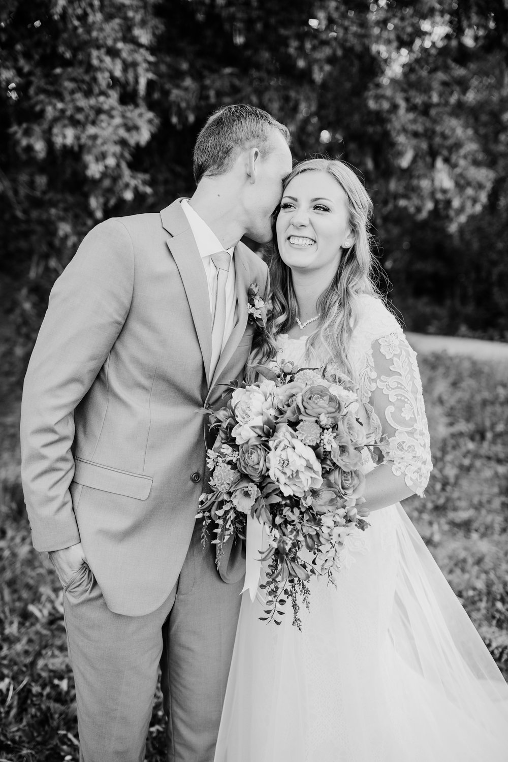 logan utah wedding photographer wildflower bouquet lace wedding dress bride and groom