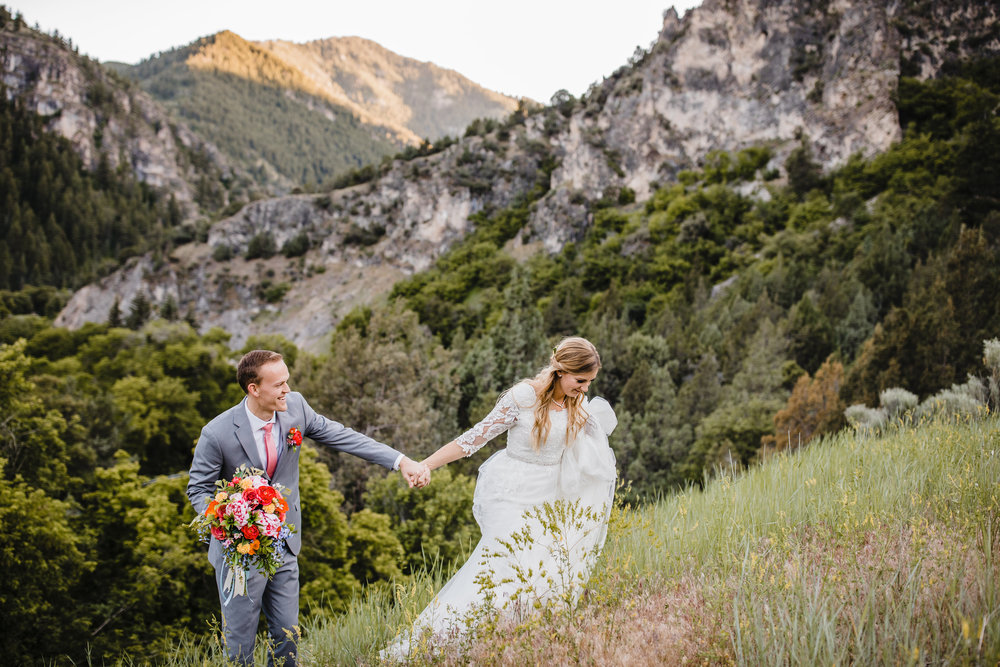 cache valley wedding photographer mountain wedding holding hands movement photography