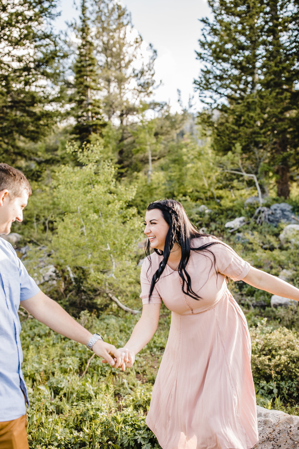 engagement photographer in utah valley mountain engagement holding hands laughing mountain exploring