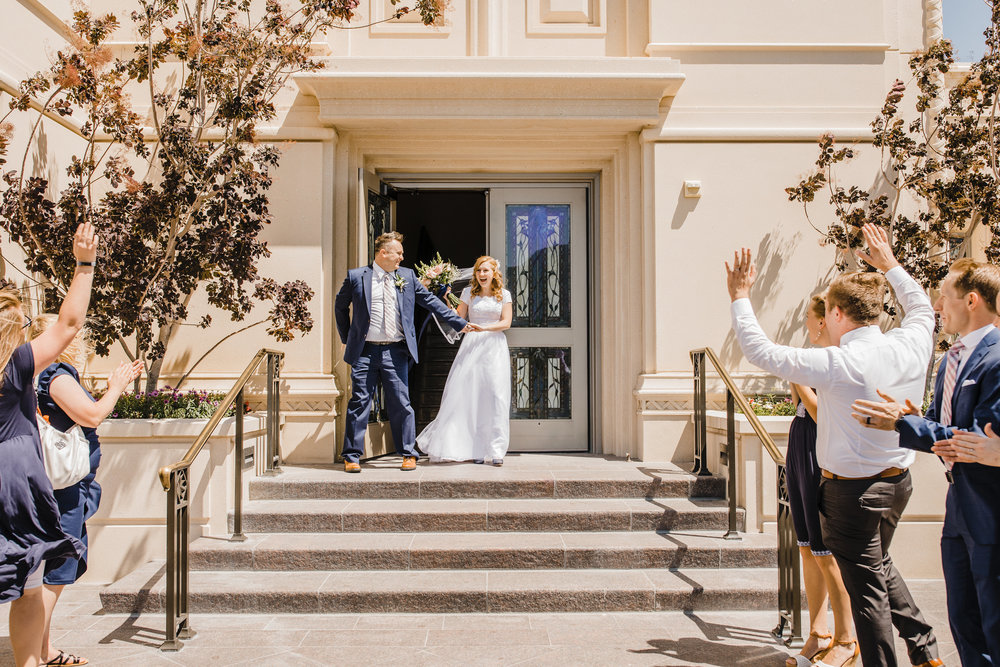 professional wedding photographer in logan utah lds temple exit happy cheering