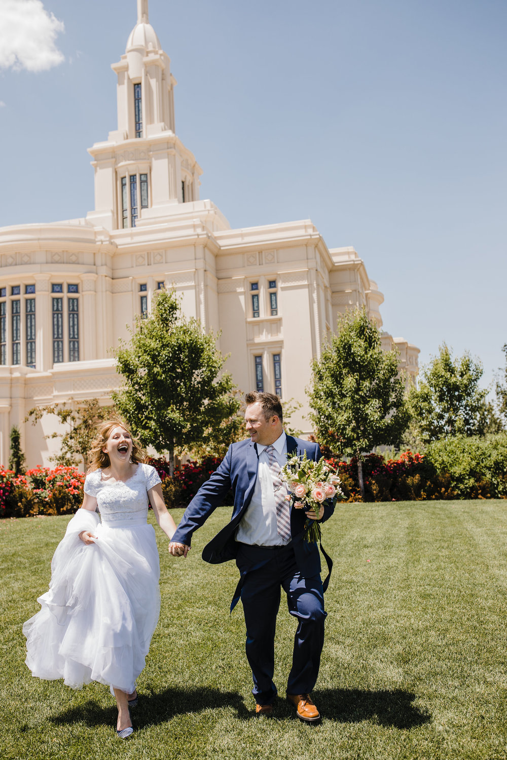 best photographer in cache valley lds temple wedding running happy holding hands