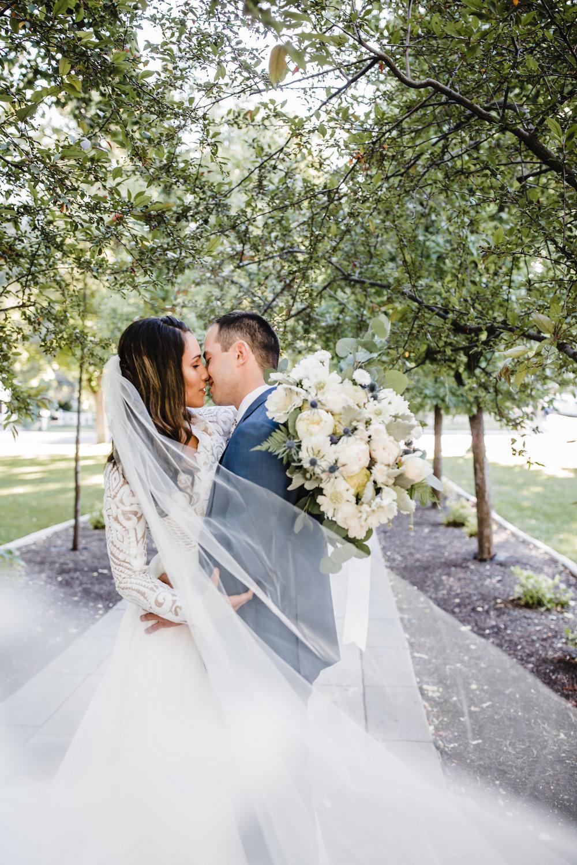 best wedding photographer in logan utah long veil bride and groom