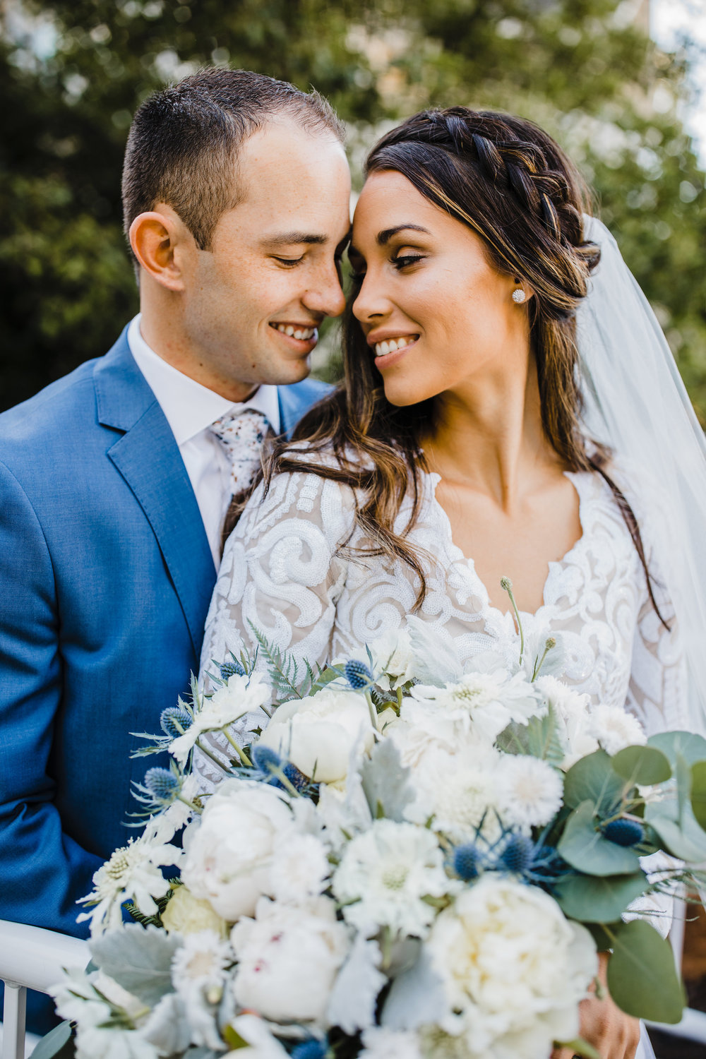 professional wedding photographer in cache valley utah bride and groom smiling wedding braid