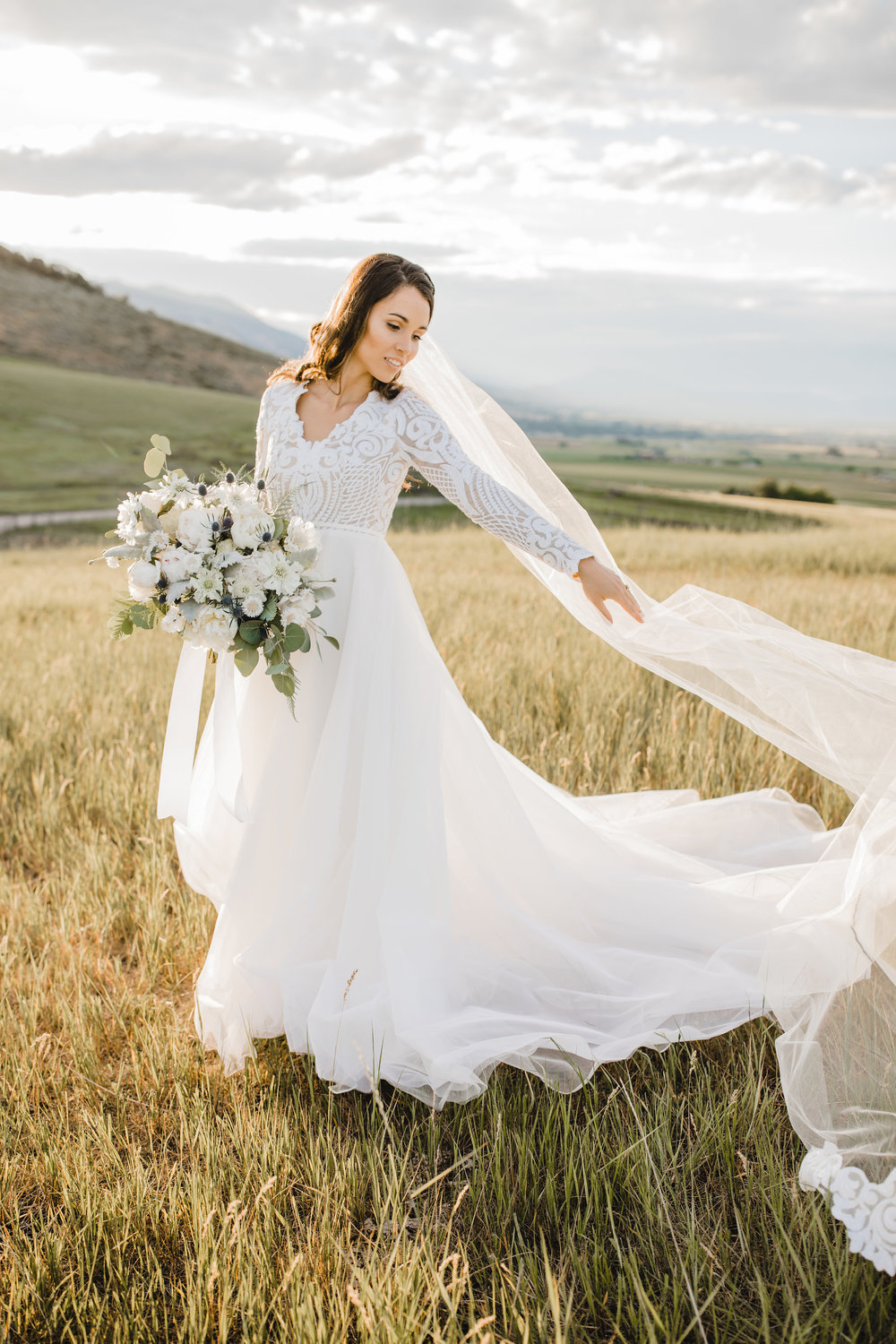 wedding photographer in cache valley long veil field mountain wedding