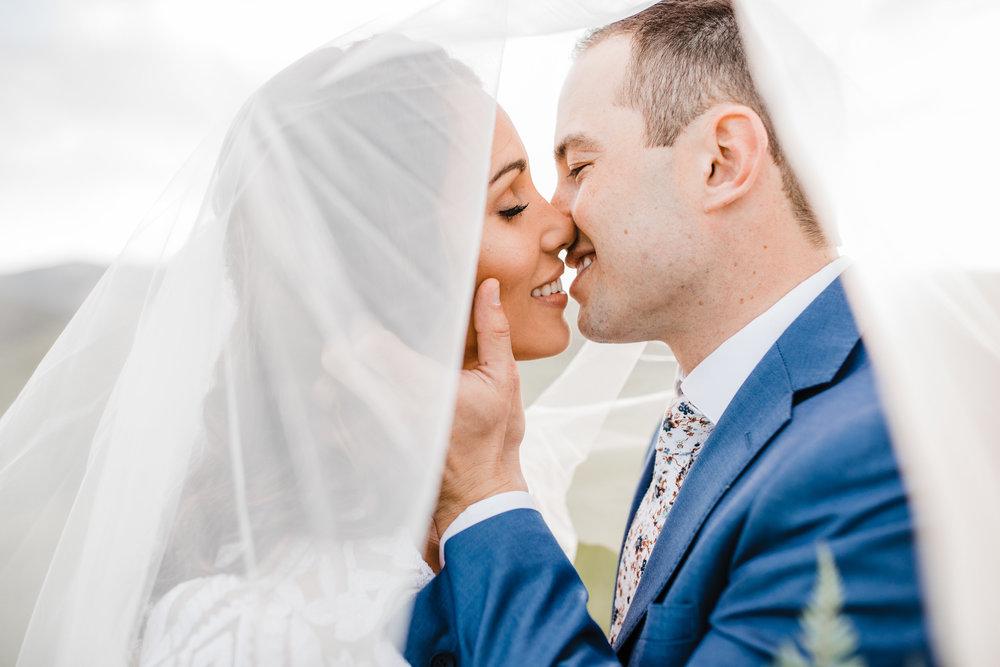 professional wedding photographer logan utah veil kissing bridals