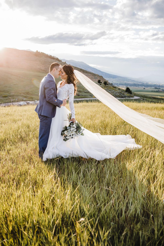 logan utah wedding photographer kissing smiling sunset mountain wedding
