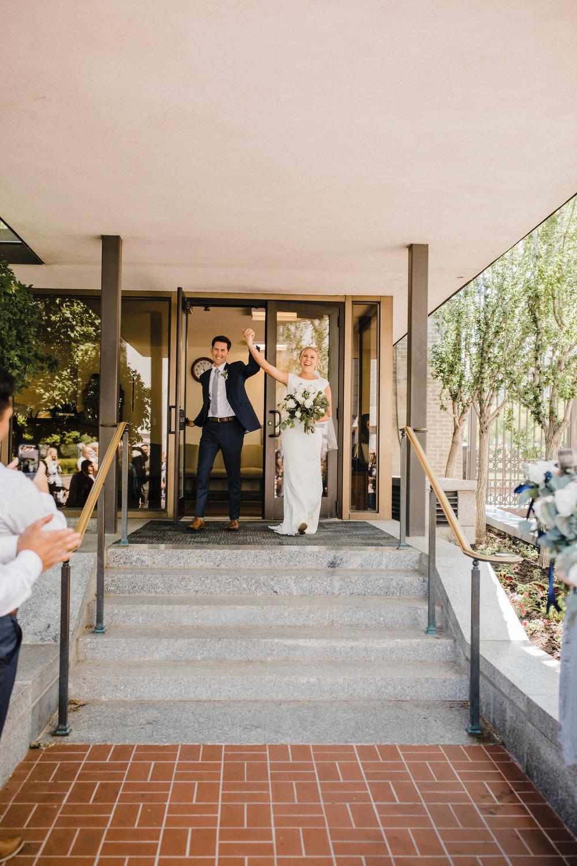 salt lake wedding photographer cheering exit lds temple