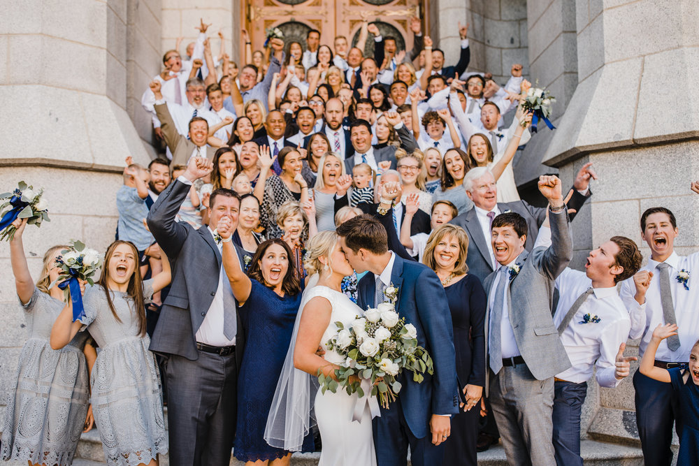 utah valley wedding photographer lds wedding exit cheering families stairs