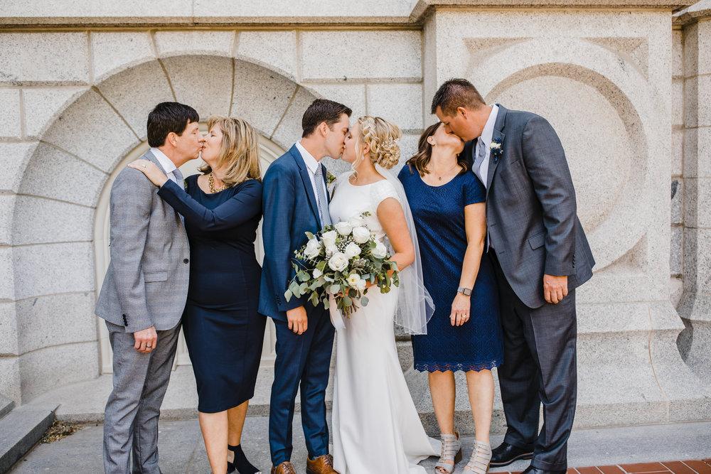 salt lake city wedding photographer families kissing