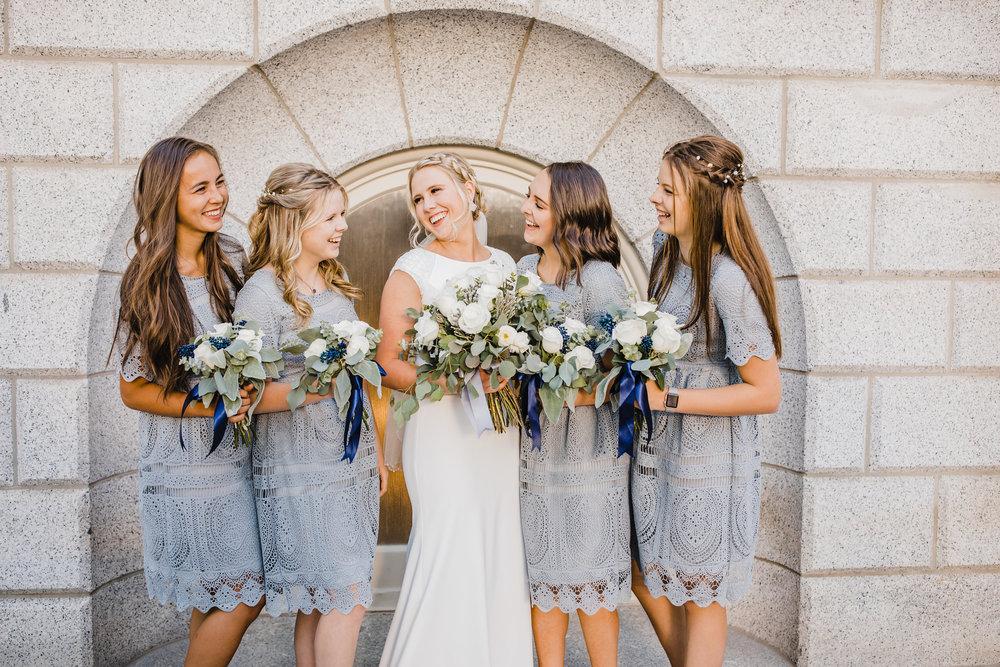 professional salt lake city wedding photographer powder blue bridesmaids dresses wedding hair smiling laughing