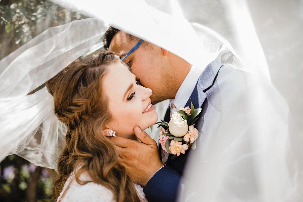 wedding photographer salt lake city temple veil kissing romantic smiling