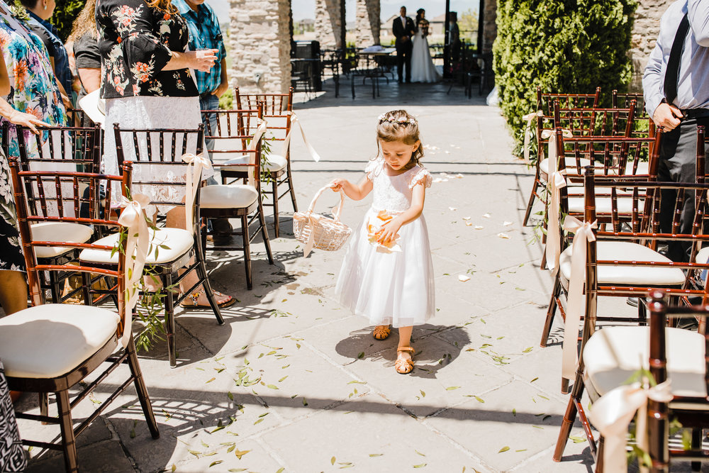 flower girl walking down the aisle on wedding day northern utah wedding photography flower girl with basket and flower crown