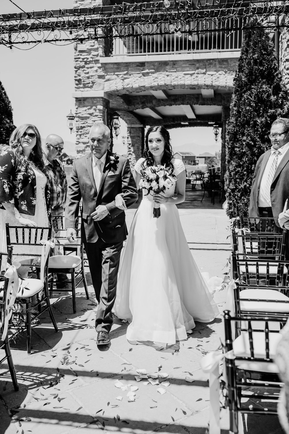 orem utah bride being walked down the aisle on wedding day black and white wedding photographer calli richards sleepy ridge golf course
