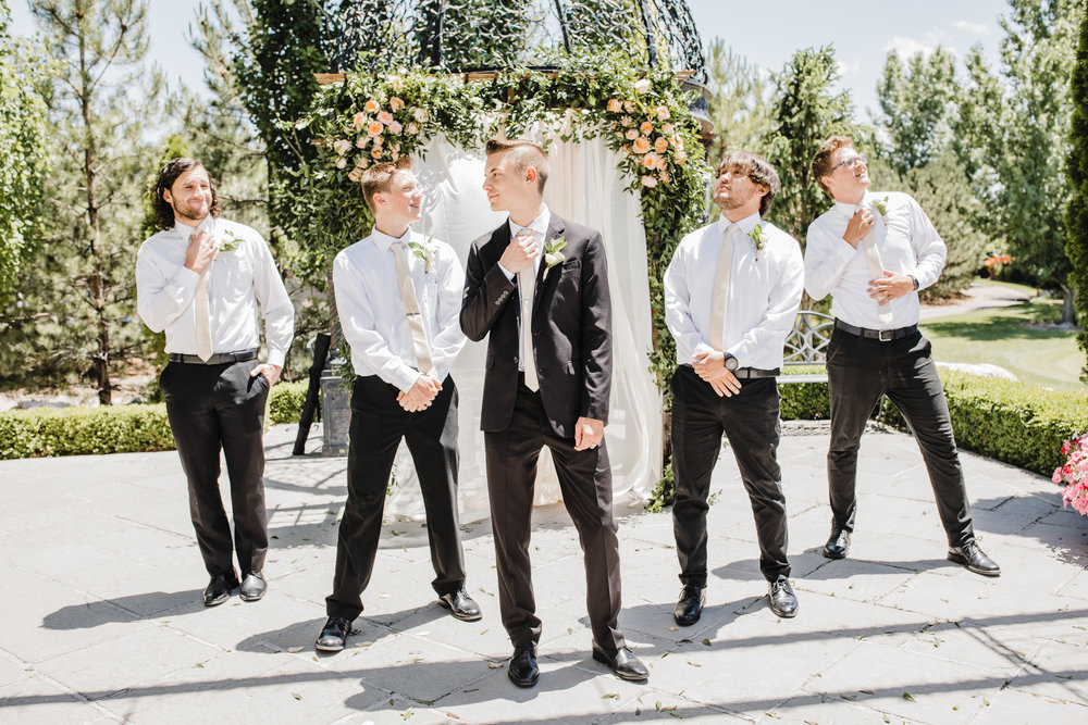 groom with groomsmen funny poses professional utah wedding day photographer calli richards