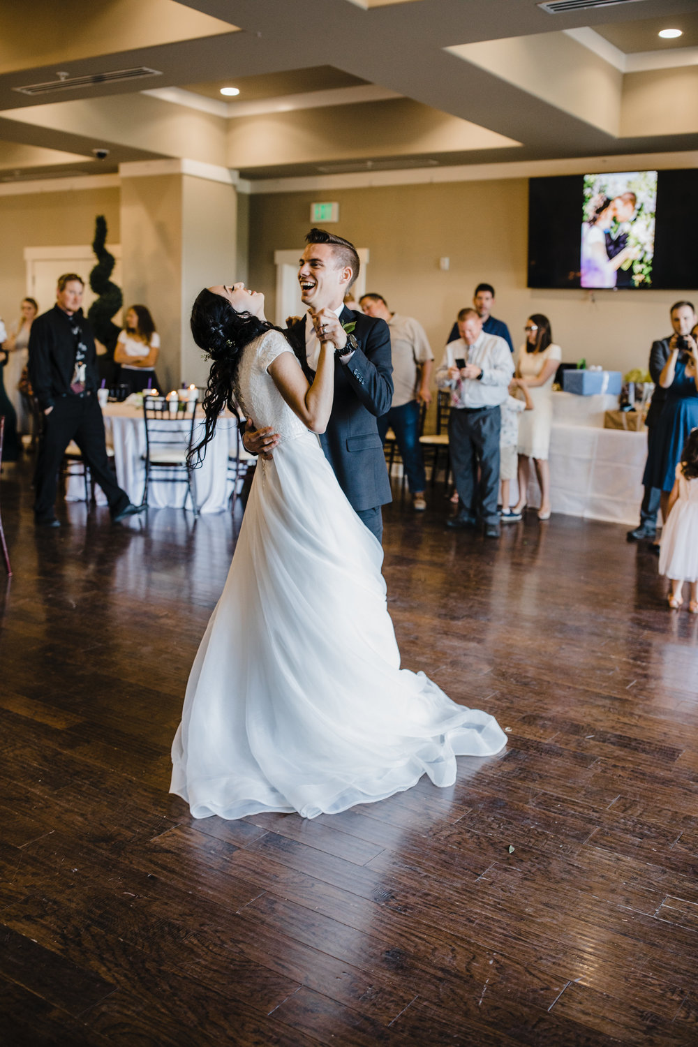 orem utah bride and groom first dance on wedding day wedding dance floor fun