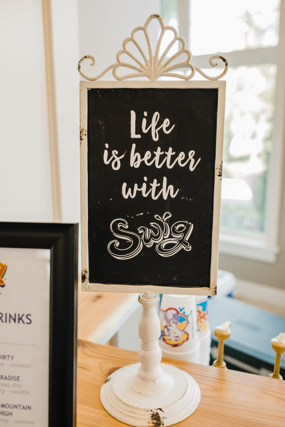 life is better with swig chalkboard sign wedding refreshments swig and sweets soda and cookies wedding day dessert table