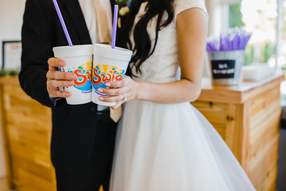 swig n sweets soda and cookies orem utah wedding day dessert caterer bride and groom with swig cups