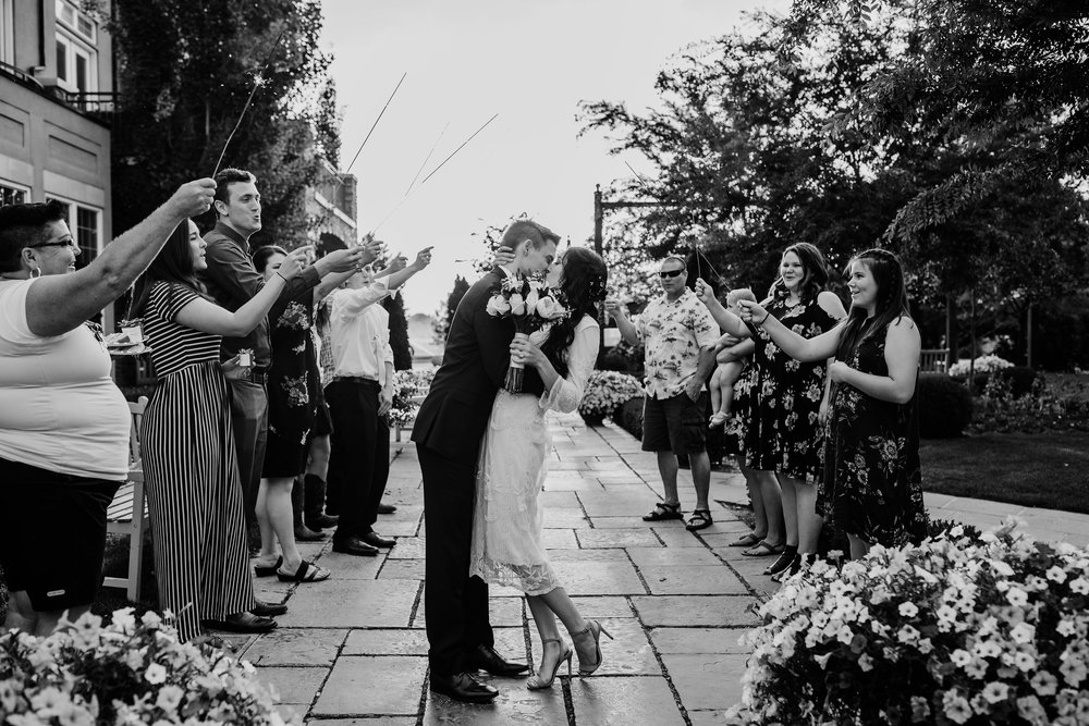 bride and groom send off northern utah wedding day photography black and white wedding photos guests with sparklers at sleepy ridge golf course