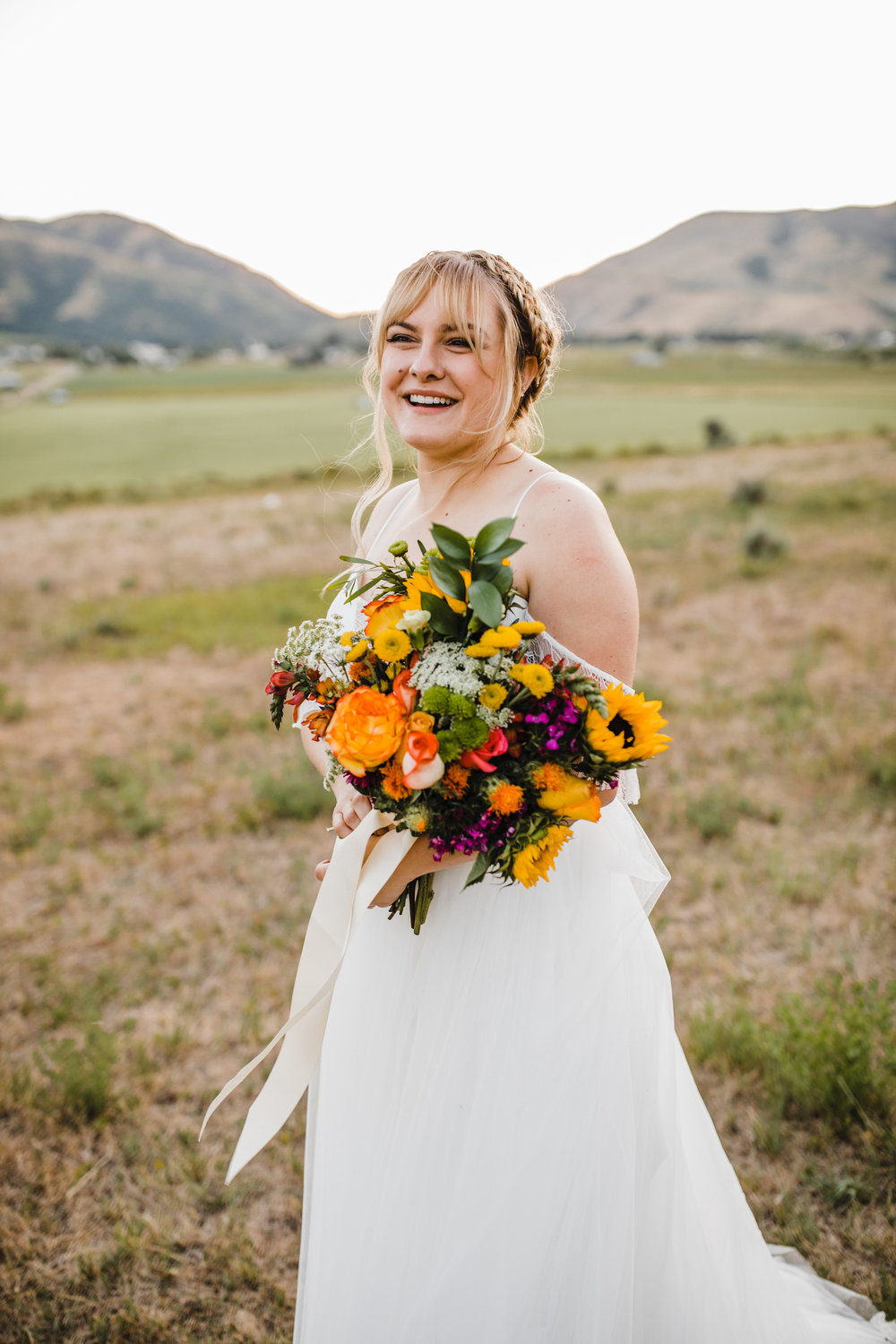 cache valley professional wedding photographer formals bridals sunflower bouquet boho braids