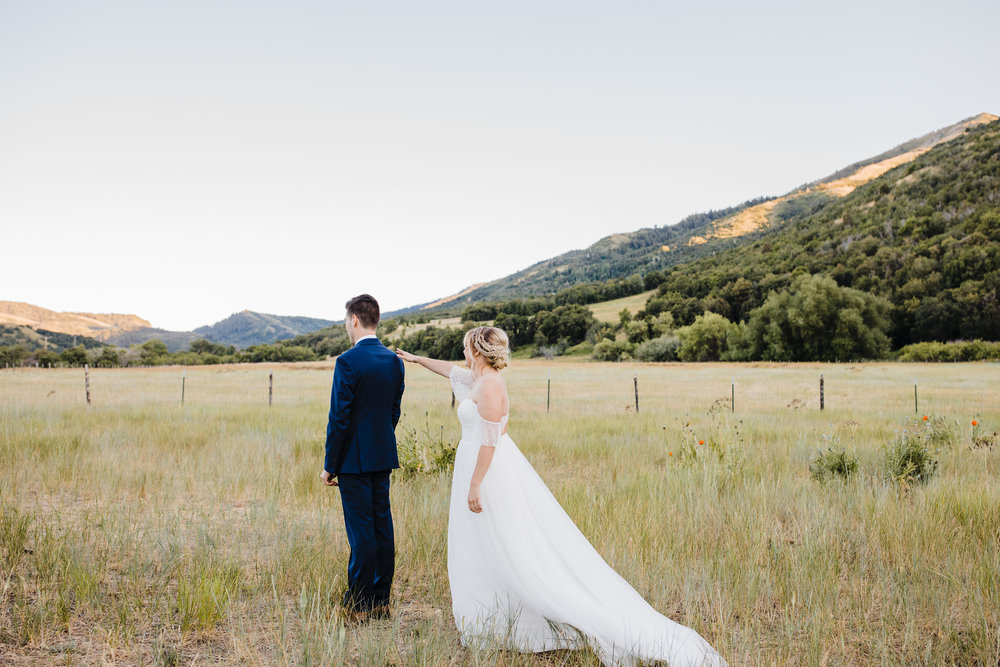 professional wedding photographer in logan utah first look mountain formals boho wedding hair