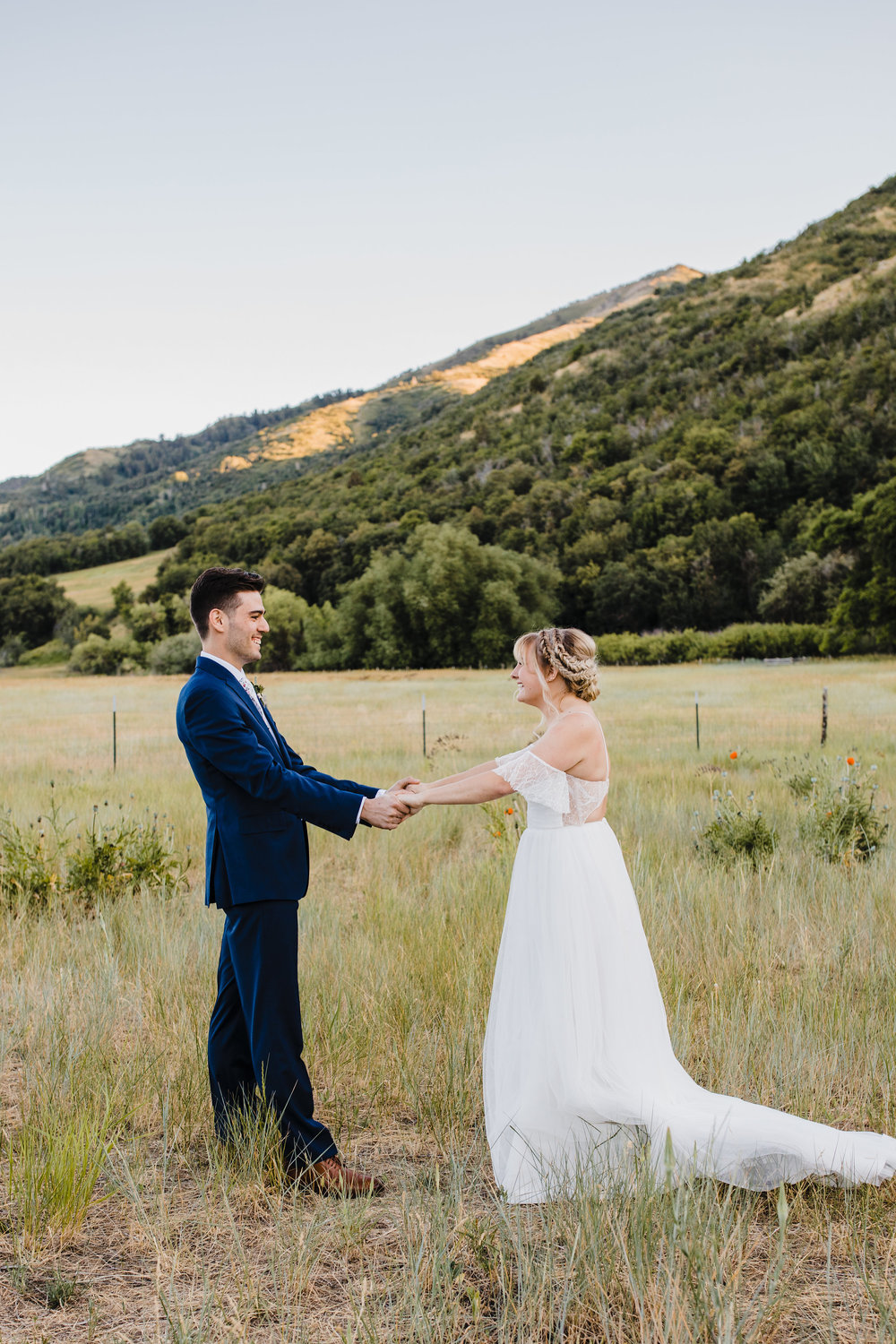 cache valley professional wedding photographer first look bohemian bride mountains smiling