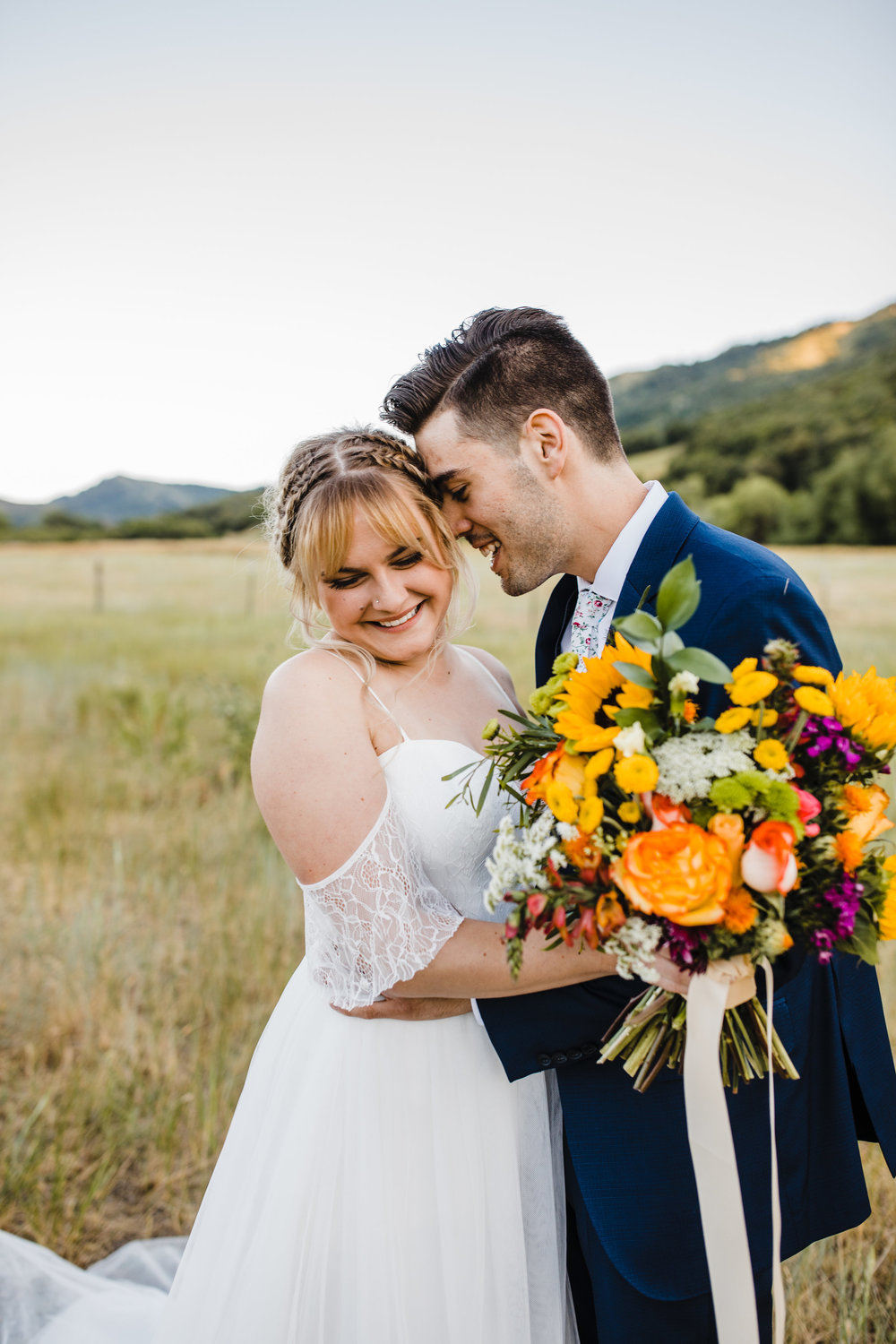 professional wedding photographer logan utah sunflower wedding bouquet yellow mountain formals