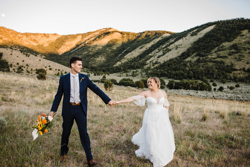 wedding photographer logan utah dancing spinning laughing holding hands