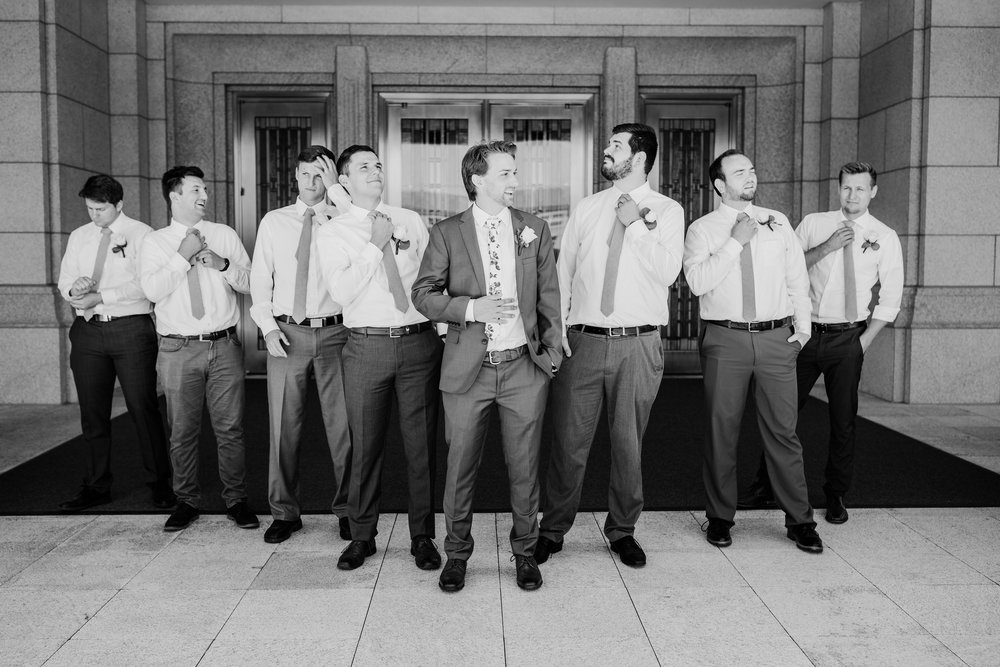 professional photographer in logan utah lds temple wedding groomsmen looking away