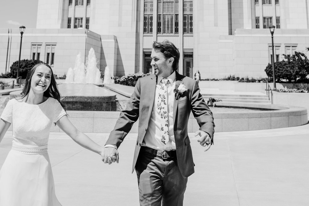 professional wedding photographer lds temple wedding exit running holding hands smiling
