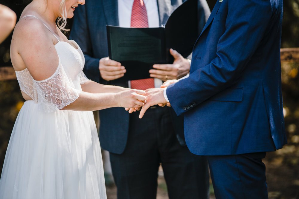 Salt Lake City utah wedding photographer outdoor bohemian wedding exchange rings