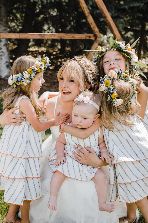 Salt Lake City professional wedding photographer flower crowns bohemian wedding dress flower girls pink happy