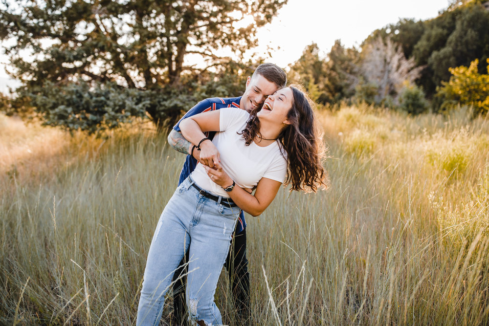 sunset engagements green canyon professional photographer laughing dipping happy