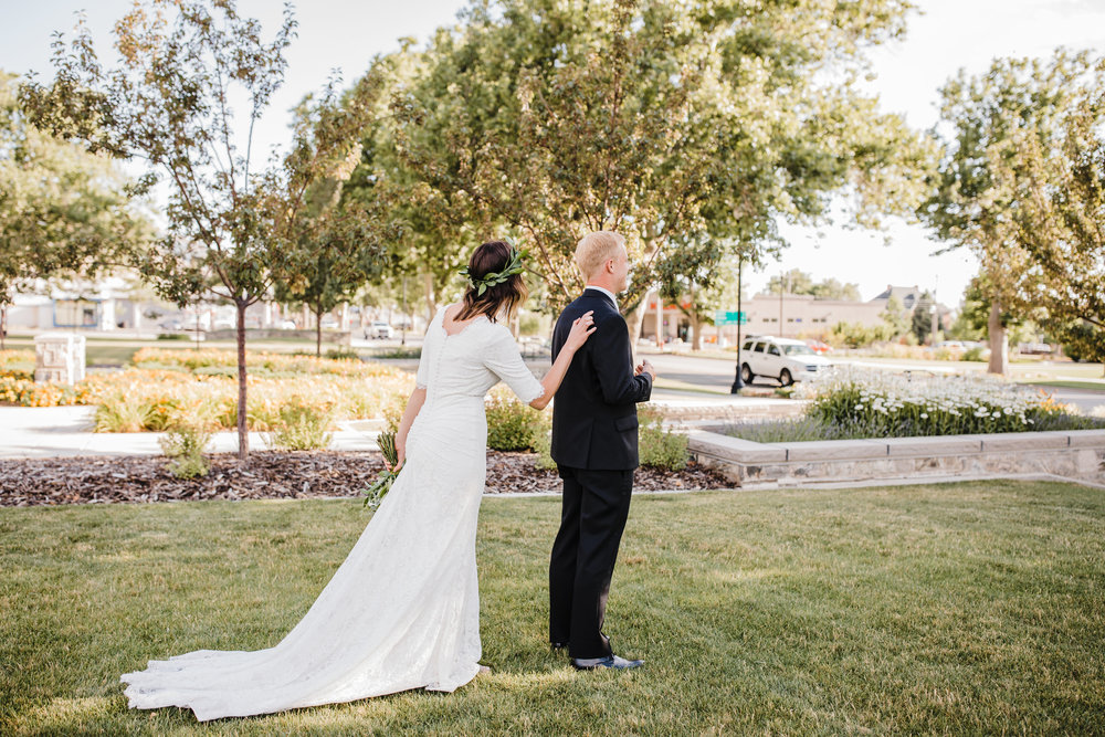 professional wedding photographer in brigham city utah lds temple first look happy shoulder tap
