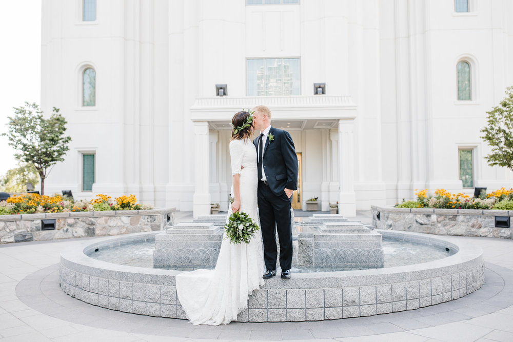 wedding photographer in brigham city utah kissing romantic temple lds fountain