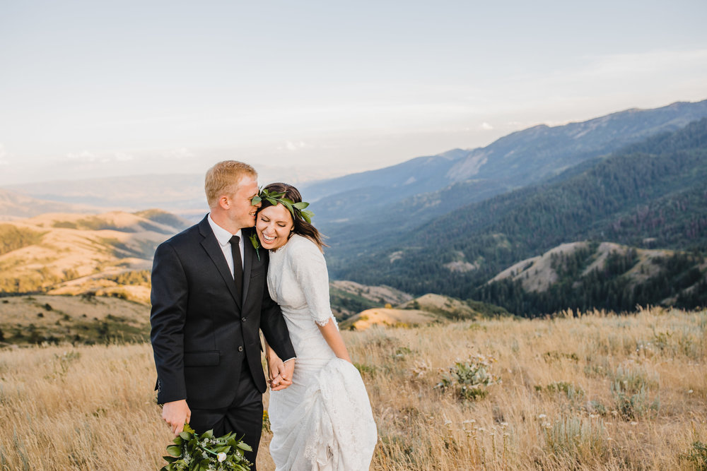 brigham city wedding photographer mountain bridals laughing flower crown holding hands