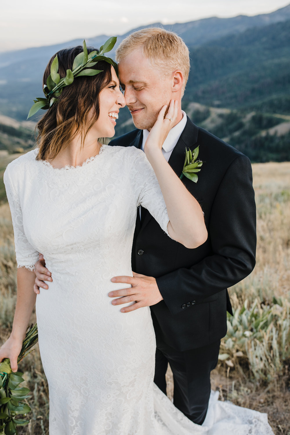 wedding photographer in brigham city utah bridals smiling kissing hugging happy romantic